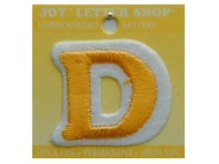 "Glass Sports: Joy Lettershop Iron-On Letter ""D"" Embroidered 1 1/2 in. Gold"