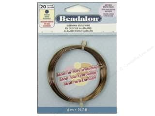 20 ga wire: Beadalon German Wire 20ga Round Antique Brass 19.7 ft.