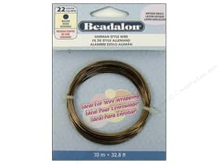 Fibre-Craft wire: Beadalon German Wire  22ga Round Antique Brass 32.8 ft.