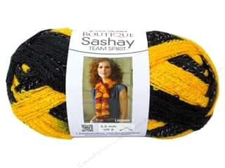 fingering yarn: Red Heart Boutique Sashay Team Spirit Yarn 3.5 oz. Gold/Black