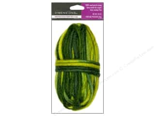 wool yarn: Dimensions 100% Wool Roving Pencil Variegated Green