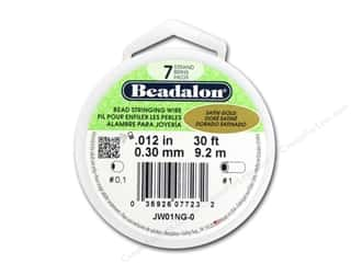 "7"" wire: Beadalon 7 Strand Bead Wire .012 in. Satin Gold 30 ft."