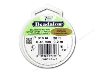 "7"" wire: Beadalon 7 Strand Bead Wire .018 in. Satin Gold 30 ft."